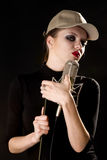 Mulher com microfone Imagens de Stock Royalty Free