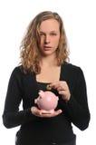 Mulher com moeda e o banco piggy Fotografia de Stock