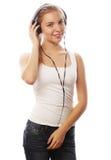 Mulher com música de escuta dos auscultadores Isolador da menina do adolescente da música Imagem de Stock Royalty Free