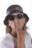 Mulher com o dedo aos bordos Fotos de Stock Royalty Free