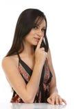 Mulher com o dedo nos bordos fotos de stock royalty free