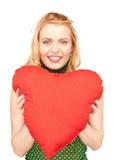 Mulher com o descanso heart-shaped vermelho foto de stock royalty free