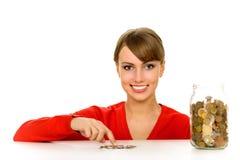 Mulher com o frasco das moedas Imagem de Stock