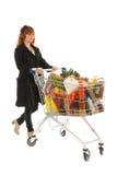 Mulher com o mantimento completo da leiteria do carrinho de compras Imagem de Stock Royalty Free