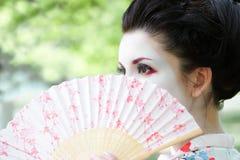 Mulher com o ventilador, retrato asiático do estilo Fotografia de Stock Royalty Free