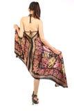 Mulher com o vestido longo que gira para trás imagens de stock royalty free