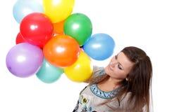 Mulher com os balões, isolados. Imagens de Stock