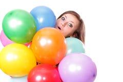 Mulher com os balões, isolados. imagem de stock