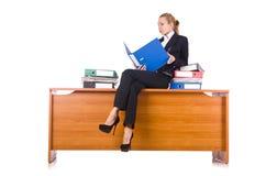 A mulher com os lotes do documento isolados no branco Fotos de Stock