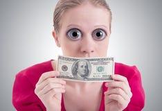 a mulher com os olhos e boca grandes fechou o dólar Imagem de Stock Royalty Free