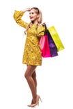 Mulher com os sacos da cor isolados no fundo branco Foto de Stock Royalty Free