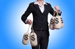 Mulher com os sacos de dinheiro Fotografia de Stock Royalty Free