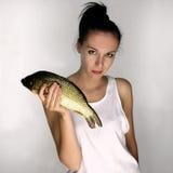 Mulher com peixes Imagens de Stock Royalty Free