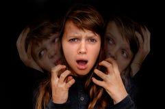 A mulher com personalidade rachada sofre da esquizofrenia Imagem de Stock