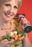 Mulher com pesos da aptidão Imagem de Stock Royalty Free