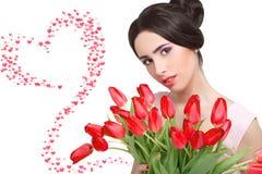 Mulher com ramalhete da tulipa Foto de Stock