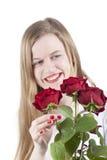 Mulher com roses.GN vermelho Imagens de Stock