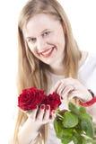 Mulher com roses.GN vermelho imagem de stock