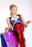 Mulher com sacos de compra Fotografia de Stock Royalty Free