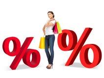 Mulher com sacos de compras e sinais de por cento Imagens de Stock