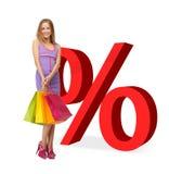 Mulher com sacos de compras e sinais de por cento Fotos de Stock