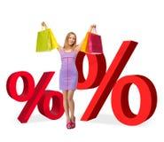 Mulher com sacos de compras e sinais de por cento Imagens de Stock Royalty Free