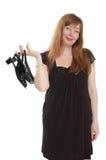 Mulher com sapatas à disposicão foto de stock