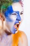 Mulher com shouting pintado da face Foto de Stock Royalty Free