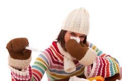 Mulher com sintomas da gripe Fotografia de Stock Royalty Free