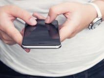 Mulher com smartphone Foto de Stock