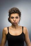 Mulher com sopro para fora seus mordentes Fotos de Stock Royalty Free