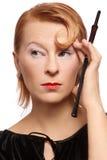 Mulher com suporte de cigarro Fotos de Stock Royalty Free