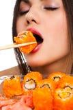 Mulher com sushi Imagem de Stock