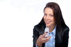 Mulher com telefone de pilha Imagens de Stock