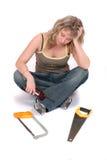 Mulher com telefone e serra Fotografia de Stock Royalty Free