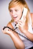 Mulher com telefone retro fotografia de stock