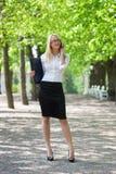 Mulher com telemóvel e portátil Fotografia de Stock Royalty Free
