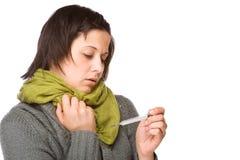 Mulher com termômetro clínico fotos de stock royalty free