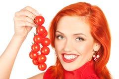 Mulher com tomates de cereja Fotografia de Stock