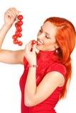 Mulher com tomates de cereja Fotos de Stock