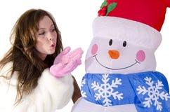 Mulher com um boneco de neve Fotos de Stock