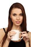 A mulher com um copo foto de stock