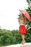 Mulher com um guarda-chuva Fotos de Stock Royalty Free
