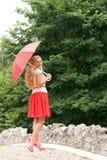 Mulher com um guarda-chuva Fotos de Stock