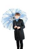 Mulher com um guarda-chuva azul Imagens de Stock Royalty Free