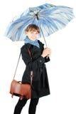 Mulher com um guarda-chuva azul Imagem de Stock Royalty Free