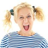 A mulher com um olhar engraçado em sua cara sorri Fotografia de Stock Royalty Free
