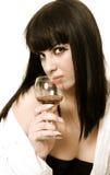 A mulher com um vidro Foto de Stock