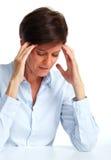 Mulher com uma dor de cabeça fotografia de stock royalty free