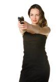 A mulher com uma pistola imagem de stock royalty free